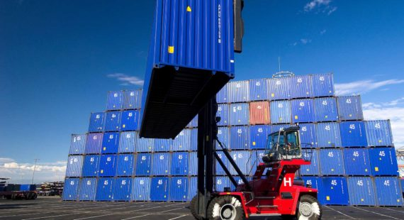 fork lift moving shipping containers